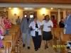 Sis. Carol Thomas escorts the Cheeks  during their first Pastors' Appreciation Day.